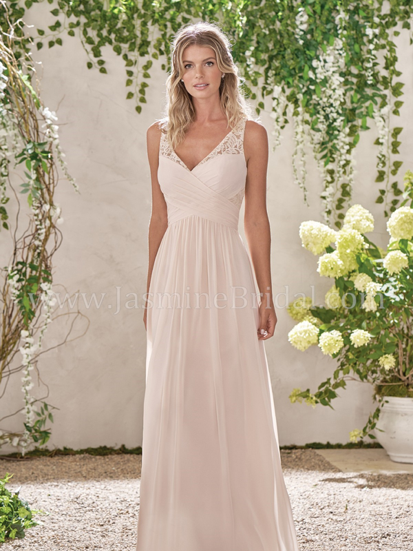 e9551d3fe8 Discription  Beautiful v-neck poly chiffon dress with ruching along the  criss-cross detail on the bodice and top of skirt. A sandstone colored dress  with ...
